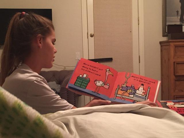 Ellie reading mom to sleep