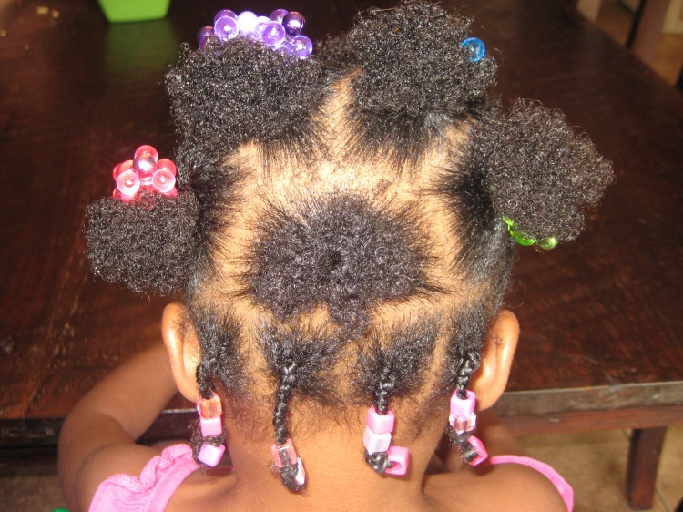 black hair care puffs and box braids